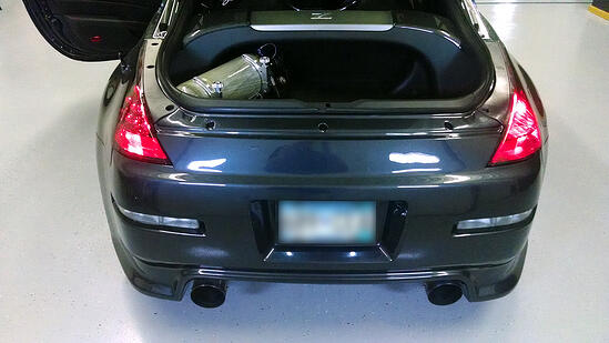 Here you can see the OEM 2006+ LED tail lights on the left (driver's side) and the original older style 2005 tail lights on the right (passenger side).