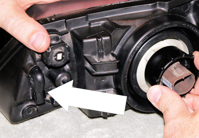 Remove bulb from back of headlight so air can circulate inside.